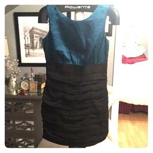 Black ruffle dress with teal satin top. Express